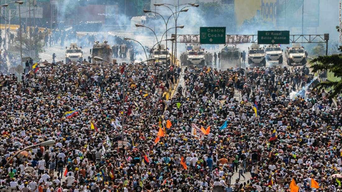 Thousands of Venezuelan protesters march on a Caracas highway on May 10.