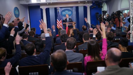 Reporters raise their hands with questions for White House Press Secretary Sean Spicer during a briefing in the Brady Briefing Room of the White House on May 1, 2017 in Washington, DC. / AFP PHOTO / MANDEL NGAN        (Photo credit should read MANDEL NGAN/AFP/Getty Images)