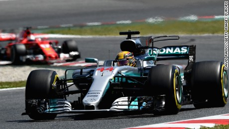 Lewis Hamilton leads from Sebastian Vettel on his way to victory in the Spanish Grand Prix in Barcelona.
