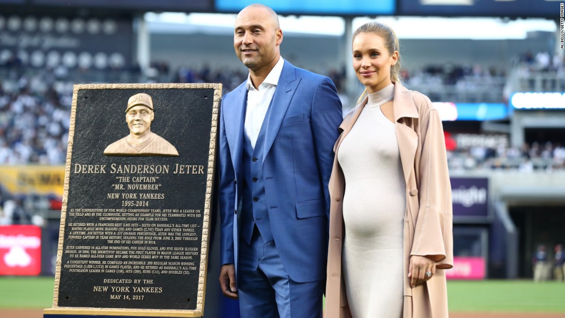 Jeter and his wife pose for photos during his retirement ceremony on May 14.