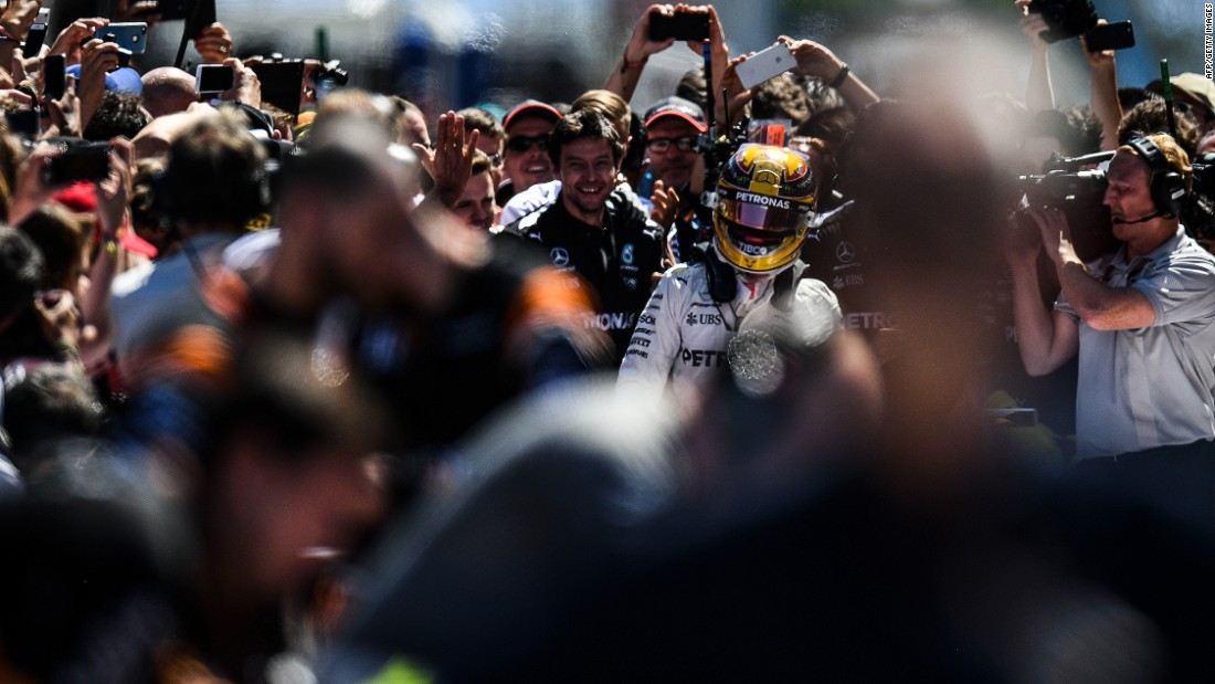Media engulf Hamilton in parc ferme after his victory in Spain. Next stop on the F1 calendar is the Monaco Grand Prix on May 28.