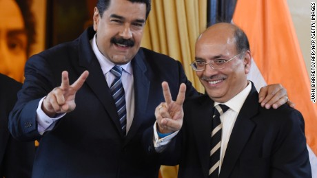 Venezuela's President Nicolas Maduro (L) and the Managing Director of Indian oil and gas company ONGC, Narendra Verma, pose for pictures after signing agreements at the Miraflores presidential palace in Caracas on November 4, 2016. / AFP / Juan BARRETO        (Photo credit should read JUAN BARRETO/AFP/Getty Images)