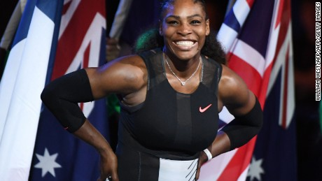 Serena Williams of the US smiles during the awards ceremony after her victory against Venus Williams of the US in the women's singles final on day 13 of the Australian Open tennis tournament in Melbourne on January 28, 2017. / AFP / WILLIAM WEST / IMAGE RESTRICTED TO EDITORIAL USE - STRICTLY NO COMMERCIAL USE        (Photo credit should read WILLIAM WEST/AFP/Getty Images)