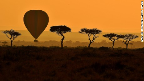 A hot air balloon carrying tourists is pictured during the annual wildebeest migration in the Masai Mara game reserve