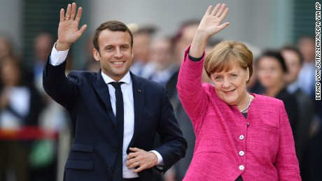 New French President Emmanuel Macron, left, and German Chancellor, Angela Merkel, in Berlin Monday