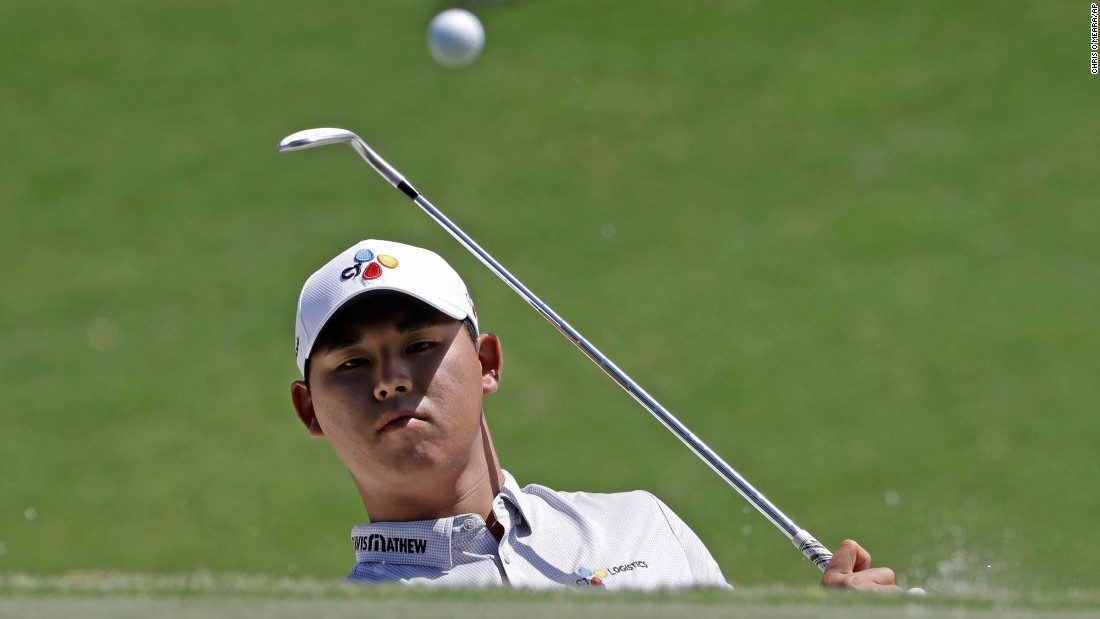 "Si Woo Kim hits the ball onto the green during the final round of The Players Championship on Sunday, May 14. The 21-year-old South Korean <a href=""http://www.cnn.com/2017/05/15/golf/kim-si-woo-tpc-sawgrass-military-service/index.html"" target=""_blank"">won the tournament</a> by three strokes. It was his second win on the PGA Tour."