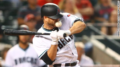 Arizona Diamondbacks catcher Chris Iannetta is hit in the face by a pitch in the seventh inning against the Pittsburgh Pirates at Chase Field.