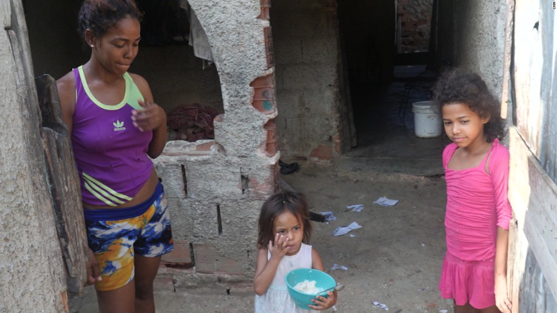 The Dias family welcomed us to their home, as Jennifer ate their first rice in a week.