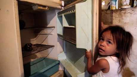 For three-year-old Jennifer, a fridge with nothing but two old pineapples is normal.