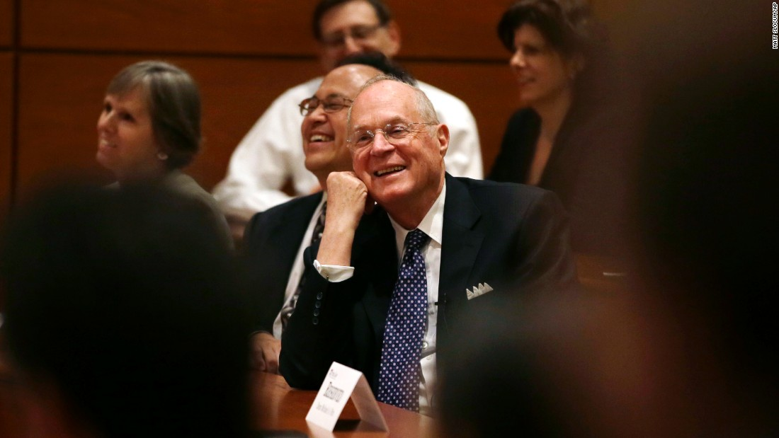 Kennedy smiles as he is introduced to faculty members at the University of Pennsylvania Law School in October 2013. Kennedy was teaching there for a week.