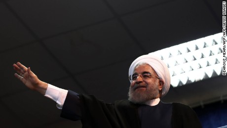 Hassan Rouhani waves to supporters during an electoral campaign gathering in the northwestern city of Zanjan on May 16, 2017.