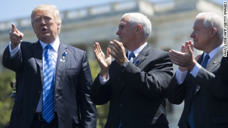 US President Donald Trump points alongside US Vice President Mike Pence (C) and Attorney General Jeff Sessions (R) during the 36th Annual National Peace Officers Memorial Service at the US Capitol in Washington, DC, May 15, 2017. / AFP PHOTO / SAUL LOEB        (Photo credit should read SAUL LOEB/AFP/Getty Images)