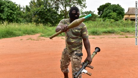 A mutinous soldier holds a RPG rocket launcher inside a military camp in the Ivory Coast's central second city Bouake.