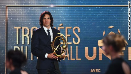 Paris Saint Germain forward Edinson Cavani reacts after receiving the French players' Ligue 1 Player of the Year award during the 26th edition of the UNFP (French National Professional Football players' Union) trophies ceremony at the Pavillon d'Armenonville in Paris, on May 15, 2017. / AFP PHOTO / FRANCK FIFE        (Photo credit should read FRANCK FIFE/AFP/Getty Images)