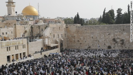 The Western Wall (R) in Jerusalem is one of the holiest sites for Jews.