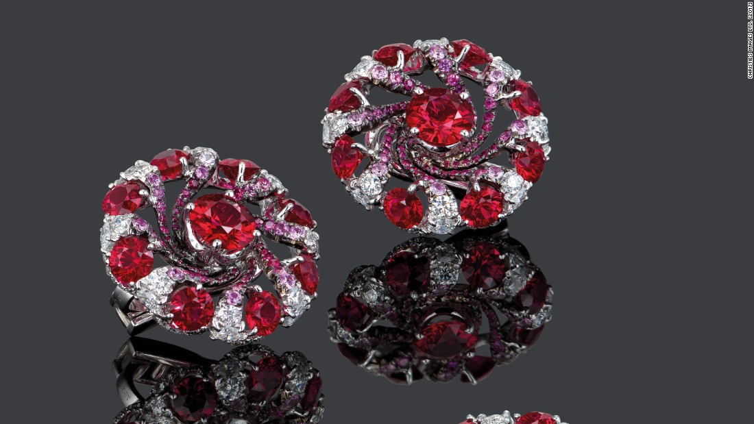 Comprising a ring and earrings, the design by Edmond Chin swirls pink sapphires and diamonds around 27 Mozambique rubies, which are famed for their purity and pop of color.