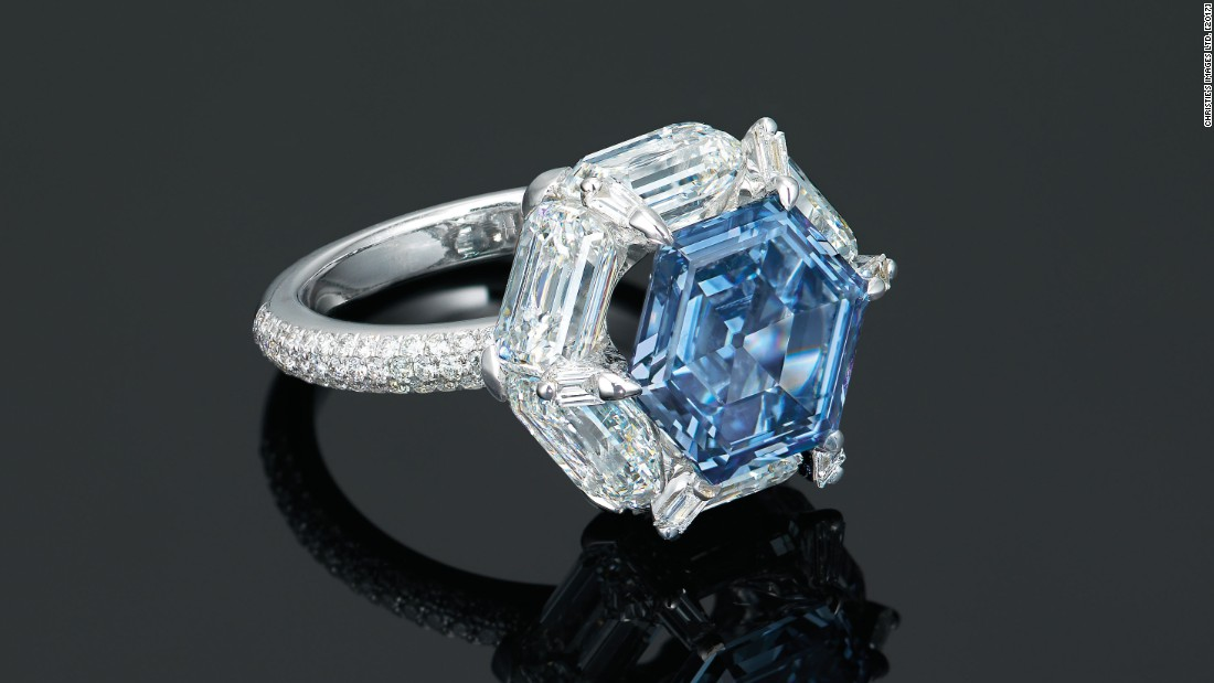 This ring by Edmond Chin features a hexagonal-shaped 3.37 carat blue diamond, encircled with tapered diamonds.