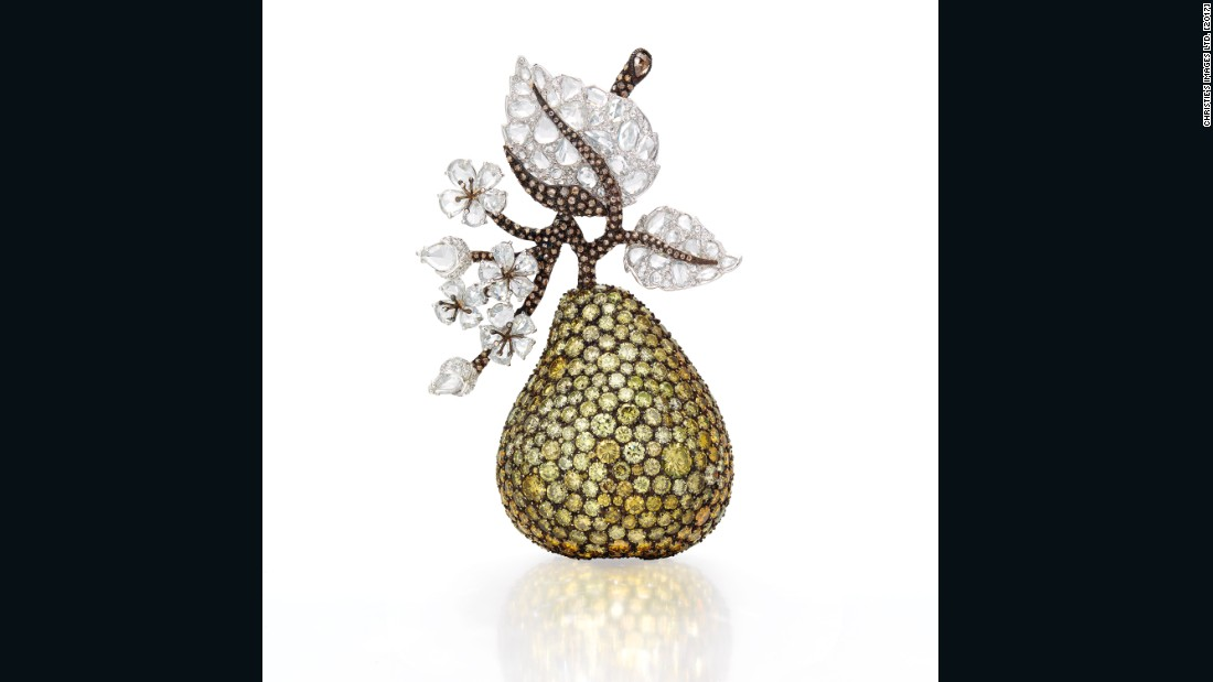 The pear by Michelle Ong features yellow and brown diamonds, topped with the rose-cut diamond foliage and brown diamond stems. These were collected over some 25 years.