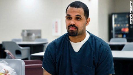 FILE - In this May 7, 2014 file photo, Rene Lima-Marin sits for an interview with The Associated Press about the circumstances of his sentencing and incarceration, in a meeting room inside Kit Carson Correctional Center, a privately operated prison in Burlington, Colo. Lima-Marin was sent back to prison after being mistakenly released 90 years early. Colorado's House of Representatives unanimously endorsed a resolution on Friday, April 21, 2017 urging the governor to grant him clemency. (AP Photo/Brennan Linsley, File)