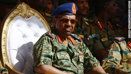 Sudanese President Omar al-Bashir watches the joint Sudan and Saudi Arabia air force drill at the Marwa air base, near Meroe some 350 kilometres north of Khartoum, on April 9, 2017.  The drills were aimed at improving the operational capacities of the two air forces, improving techniques related to air operations and promoting cooperation. / AFP PHOTO / ASHRAF SHAZLY        (Photo credit should read ASHRAF SHAZLY/AFP/Getty Images)
