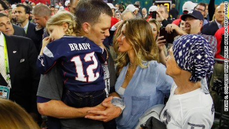 New England Patriots quarterback Tom Brady celebrates with wife Gisele Bundchen on February 5, after defeating the Atlanta Falcons in Super Bowl LI at NRG Stadium in Houston.