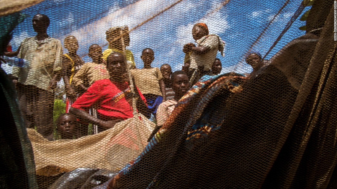 Burundian refugees gather in the fishing village of Kagunga on the shores of Lake Tanganyika in 2015. Fishing yield has declined in recent years, partially because of unsustainable practices and an influx of displaced people settling in the region.
