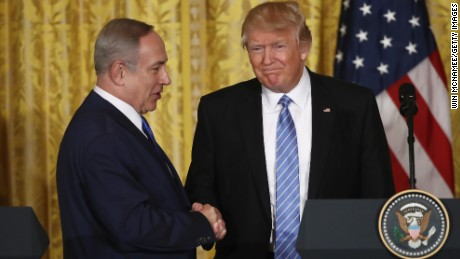 Trump and Netanyahu shake hands during a joint news conference at the White House in February