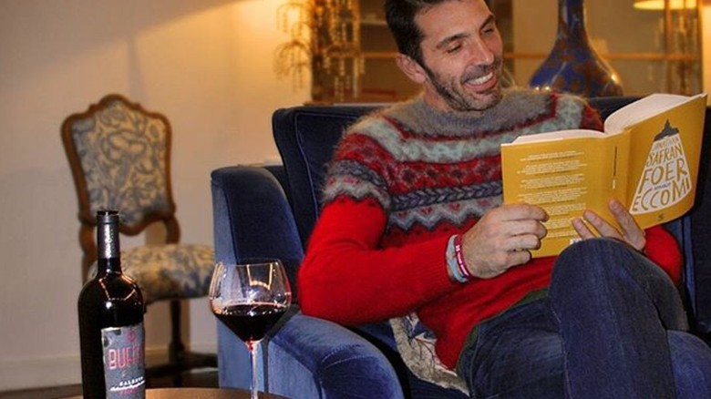 The grapes of enjoyment ... Buffon savours a glass of his own win.