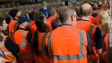 British Prime Minister Theresa May speaks to employees at a ScrewFix distribution centre on May 16, 2017 in Stoke On Trent, United Kingdom.