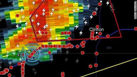 Storm chasers (red dots) converge on a tornado warning storm (red box) in western Oklahoma.