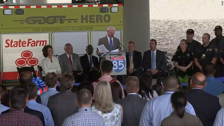GDOT Commissioner Russell McMurry speaks at a ribbon-cutting ceremony near the rebuilt bridge Thursday, days after traffic resumed.