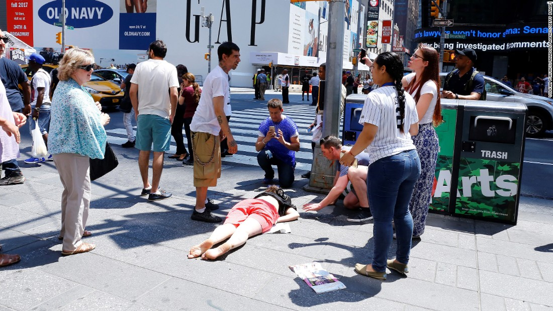 An injured person lies at the scene.