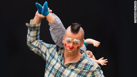 "Portrait of clown Sandor Eke and his son Michael Eke. ""I [was] born in Hungary and my parents were worked in the circus. [Since] I was one and a half years old, my mom and my dad, both worked in circus. She [was] an announcer and my dad became a tent master. For me lions and tigers and elephants walking around me was just natural. [We traveled] from town to town. My son was born into the circus and many people ask me 'Oh, next generation of clowns, performers,' and I'm like 'Absolutely not! He's going to be a dentist, a lawyer, a professional athlete, a millionaire, a billionaire, I don't know.' But of course, it's kind of a joke. If he likes it, if he has skills for it. I mean... he's already trying to juggle. He can disappear really fast, so he might be a magician. I don't know.""