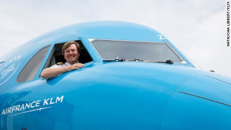 Dutch King Willem-Alexander looks out of the cockpit of a KLM aircraft. The monarch revealed that he'd been piloting KLM planes for over 20 years.