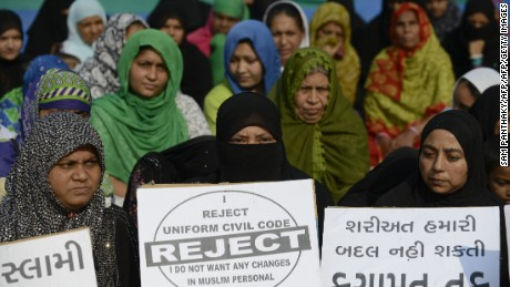 "Indian Muslim women participate in a rally to oppose the Uniform Civil Code (UCC) that would outlaw the practice of ""triple talaq"" in Ahmedabad in 2016."