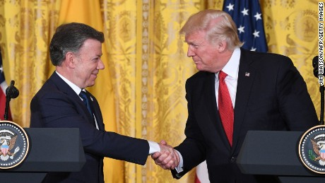 Colombia's President Juan Manuel Santos (L) shakes hands with US President Donald Trump  during a joint press conference at the White House on May 18, 2017 in Washington, DC.