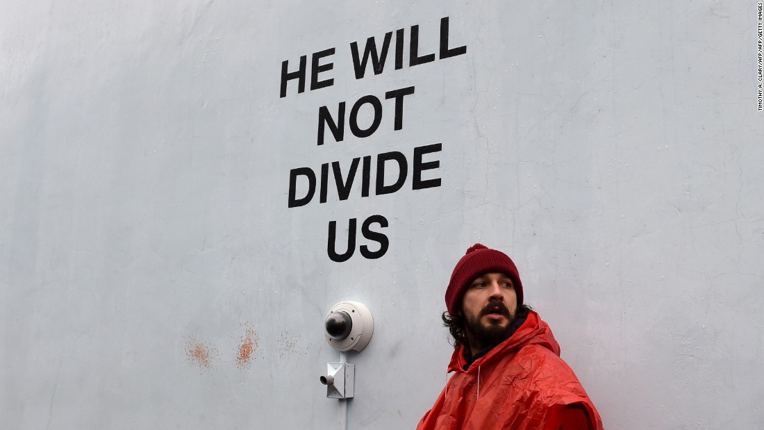 "Shia LaBeouf's latest venture, ""He Will Not Divide Us,"" has lived a troubled life. Located outside the Museum of Moving Image in New York, the actor-turned-artist invited the public to speak into the camera and repeat the title in a show of unity in the wake of the 2016 US presidential election. LaBeouf was forced to shut down on Feb. 10 when it became a flashpoint for violence, resulting in multiple arrests. <br /><br />He moved the piece to New Mexico, where it was covered in spray paint and then closed less than a week in when gunshots were heard in the vicinity. It was then relocated to Liverpool, England, where it was shut down on police advice one day in after political protesters scaled the building and tried to tear down part of the installation."