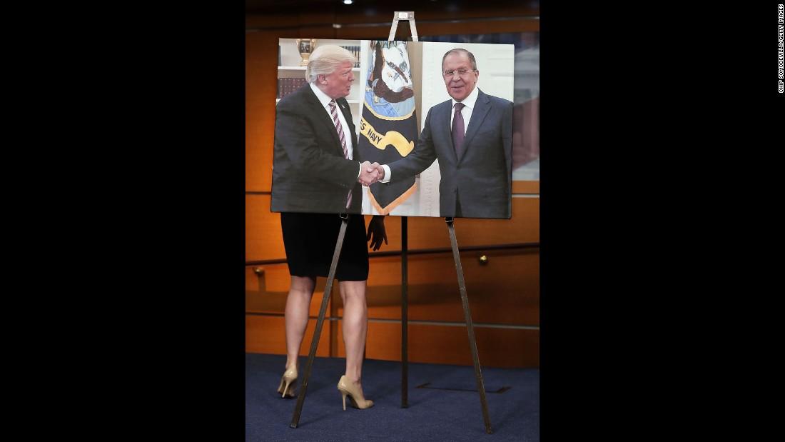 "During a news conference on Wednesday, May 17, House Democrats display of photo of US President Donald Trump shaking hands with Russian Foreign Minister Sergey Lavrov. The Democrats were calling for an independent commission that would investigate Russian interference in the 2016 election. Later in the day, the Justice Department <a href=""http://www.cnn.com/2017/05/17/politics/special-counsel-robert-mueller/"" target=""_blank"">appointed a special counsel,</a> former FBI Director Robert Mueller, to oversee a federal investigation. In a statement, Trump said an investigation will confirm that ""there was no collusion"" between his campaign and Russia."