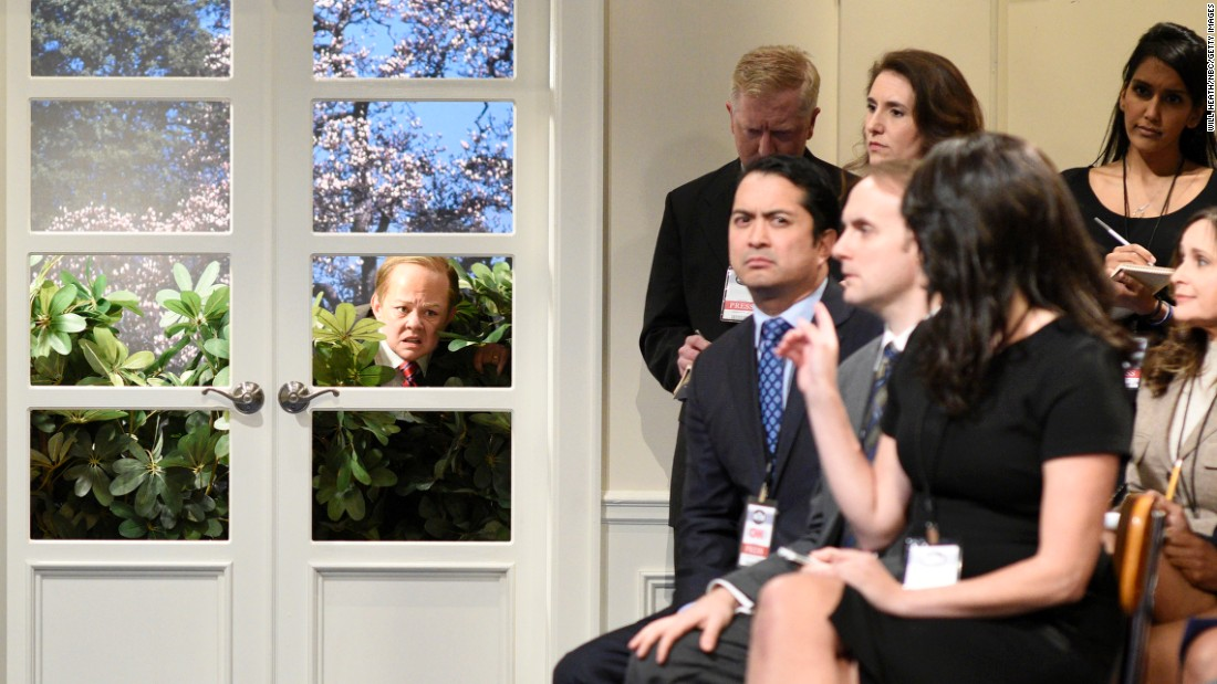 "Melissa McCarthy, playing White House press secretary Sean Spicer, hides in some bushes during a ""Saturday Night Live"" skit on May 13. McCarthy <a href=""http://money.cnn.com/2017/05/14/media/saturday-night-live-melissa-mccarthy-sean-spicer/"" target=""_blank"">has portrayed Spicer</a> several times this season."