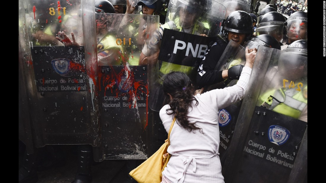 "Police shields are splattered with red paint during an opposition protest in Caracas, Venezuela, on Friday, May 12. Venezuela <a href=""http://www.cnn.com/2017/04/12/world/gallery/venezuela-protests/index.html"" target=""_blank"">has been in a state of widespread unrest</a> since March 29, when the Venezuelan Supreme Court dissolved parliament and transferred all legislative powers to itself. Though the decision was reversed three days later, protests continued across the country, which is in the midst of a severe food shortage and economic crisis."