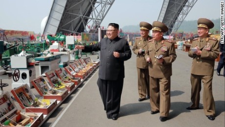 This undated photo released by North Korea's official Korean Central News Agency (KCNA) on May 13, 2017 shows North Korean leader Kim Jong-Un (L) at an exhibition of utensils and tools, finishing building materials and sci-tech achievements organised by the Ministry of the People's Armed Forces.