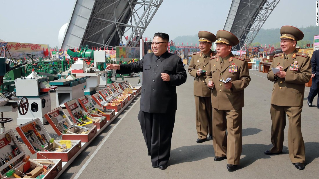 This undated photo, released by North Korea's state-run news agency on Saturday, May 13, shows North Korean leader Kim Jong Un at an exhibition of utensils, tools and other building materials.