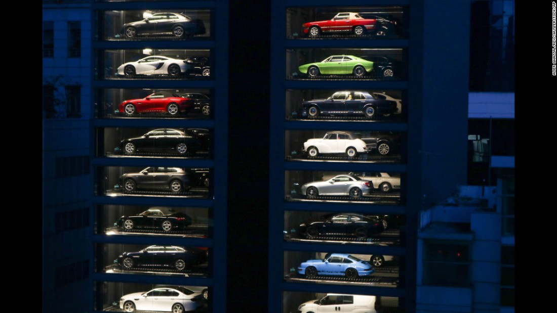 "Luxury cars fill <a href=""http://money.cnn.com/2017/05/16/news/sports-car-vending-machine-singapore/"" target=""_blank"">a 15-story ""vending machine""</a> at a dealership in Singapore on Wednesday, May 17. Autobahn Motors created the tower to save space."