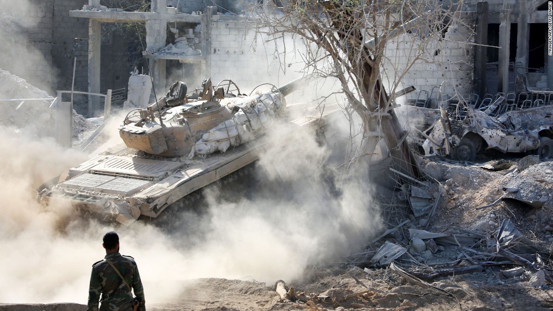 A Syrian tank advances through the Qabun district, on the outskirts of Damascus, during an offensive against opposition fighters on Saturday, May 13.