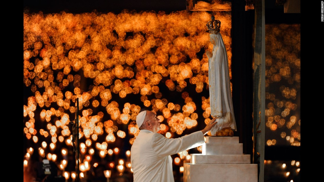 Pope Francis leads a candlelight vigil in Fatima, Portugal, on Friday, May 12. The next day, he canonized two shepherd children who lived 100 years ago.