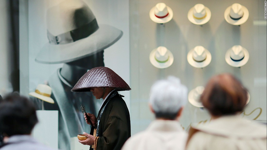 A Buddhist monk offers prayers in Tokyo's Ginza shopping district on Tuesday, May 16.