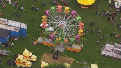 The Ferris wheel cart abruptly flipped and sent three passengers up in the air.