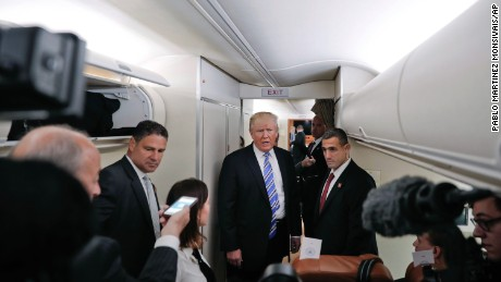 President Donald Trump speaks to members of the media aboard Air Force One before his departure from Andrews Air Force Base, Md., Saturday, May 13, 2017. Trump is traveling to Lynchburg, Va., to give the commence address for the Class of 2017 at Liberty University. (AP Photo/Pablo Martinez Monsivais)