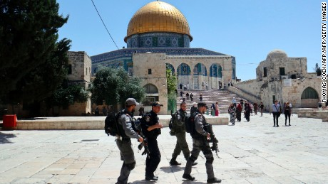 Israeli police walk past the Dome of the Rock on May 16, 2017.