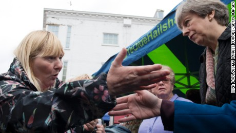 PM Theresa May is confronted by a woman about cuts to her disability benefits during an election campaign walkabout.